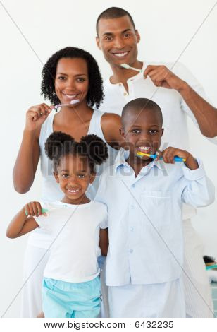 Smiling Family Brushing Their Teeth