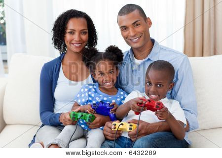 Smiling Afro-american Family Playing Video Games