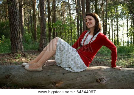 Woman on old trunk