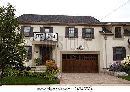 Stucco Townhouse Wood Garage
