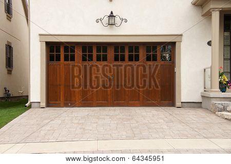Wood Garage Door Stone Driveway