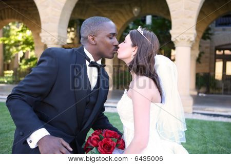 Man And Woman Interracial Wedding Couple Kiss