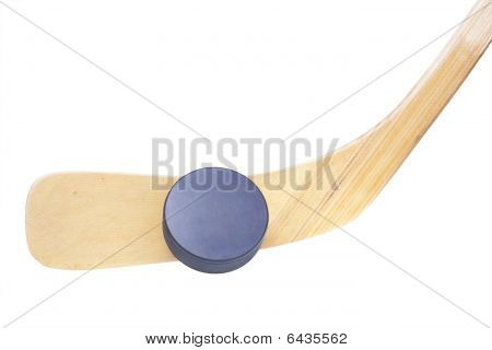 Ice Hockey Stick And Puck Isolated On White