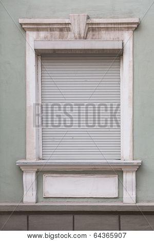 White Window Closed Grey Roller Shutters.