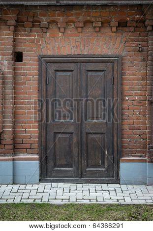 Old, Vintage, Wooden Door In A Brick Wall.