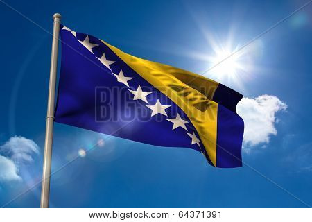 Bosnian national flag on flagpole on blue sky background