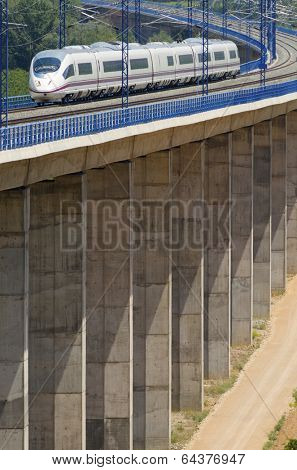 view of a high-speed train crossing a viaduct in Calatayud, Saragossa, Aragon, Spain, AVE Madrid Barcelona.