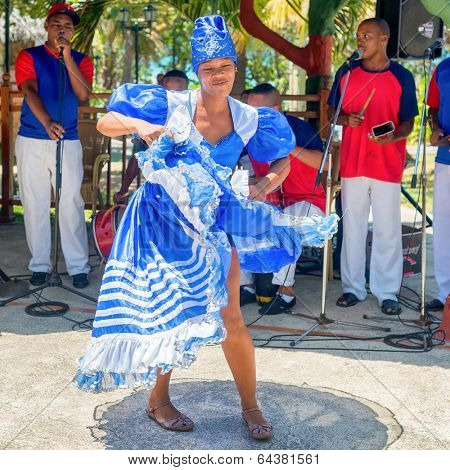 VARADERO,CUBA - APRIL 26,2014 : Afrocuban dancer and traditional music band playing for tourists at a seaside resort