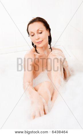 Attractive Woman Enjoys  In The Bathtub.