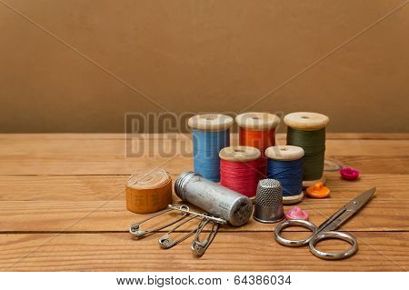 Background With Sewing Tools And Colored Thread