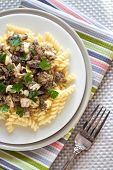 stock photo of morels  - Spiral pasta with morel mushrooms and parsley leaves - JPG