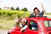 pic of say goodbye  - Senior happy couple driving vintage car - JPG