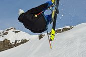 stock photo of suny  - jumping skier at mountain winter snow fresh suny day - JPG
