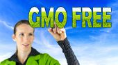 stock photo of modification  - GMO Free conceptual image with a girl reaching up to touch text  - JPG