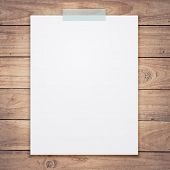 stock photo of memory stick  - Empty white paper sheet stick on wood texture background - JPG