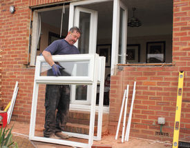 pic of windows doors  - A Window fitter removing old windows and doors in preparation for new plastic ones to be fitted - JPG