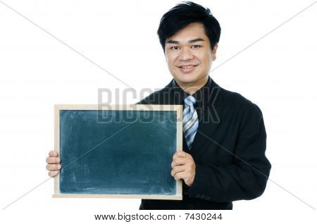 Portrait of a handsome young businessman holding a blackboard