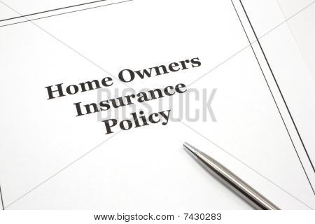 Home Owners Insurance Policy With A Pen