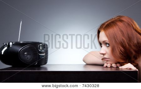 Young Woman Listening Radio