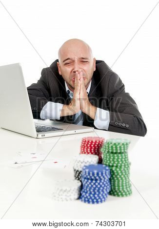Internet Gambling Addict Businessman On Computer Loosing Lots Of Money Betting On Poker Game
