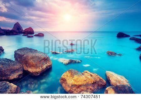 Fantastic morning blue sea glowing by sunlight. Dramatic scene. Black Sea, Crimea, Ukraine, Europe. Beauty world. Retro style filter. Instagram toning effect.