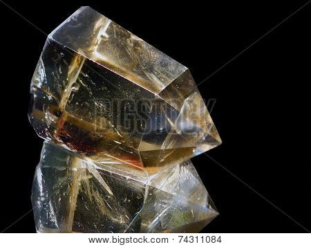 Crystal Of Topaz Of Tea Color On A Black Background