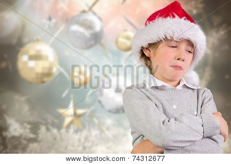 Festive boy sulking against blurred christmas background