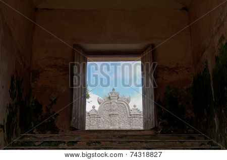 framing the top of gapura agung - the main gate at taman sari water castle - the royal garden of sul