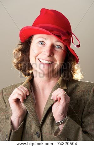 Brunette In Red Hat Holding Jacket Lapels