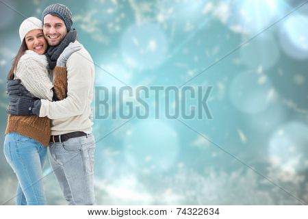 Young winter couple against blurred christmas background