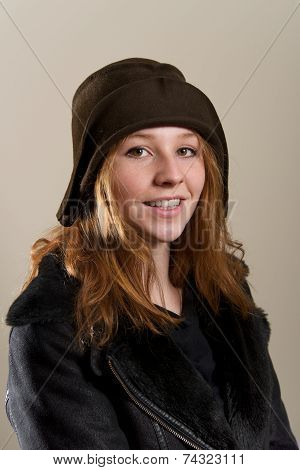 Redhead In Cloche Hat And Leather Jacket
