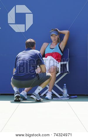 Five times Grand Slam champion Maria Sharapova practices with her coach Sven Groeneveld for US Open