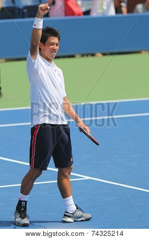 Professional tennis player Kei Nishikori celebrates victory after first round US Open 2014