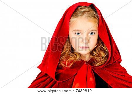 Beautiful little girl in a red raincoat with a hood. Little Red Riding Hood. Isolated over white.