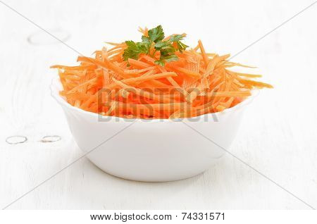 Grated Carrot In Bowl On White Table