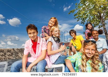 Positive multinational group of kids sit together