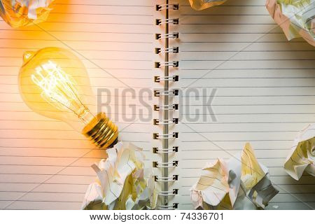 Note book and light bulb