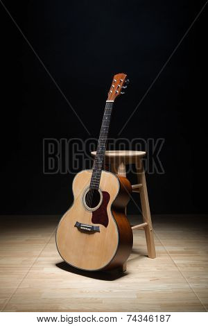 Acoustic guitar on the floor.