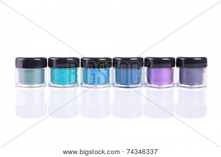 Mineral eye shadows in clear plastic jars, isolated on white background with natural reflection