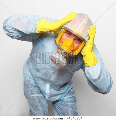Man in protective clothing with gas mask. Infection control and allergy concept.