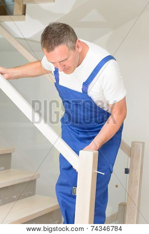 Carpenter working  on stairs
