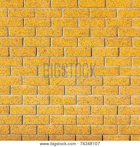 Energetic Yellow Brick Wall As A Background Image With Black Vignette.