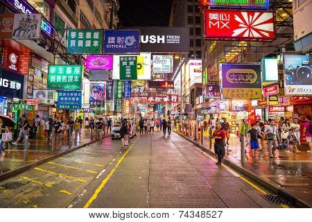 HONG KONG , CHINA - AUG 13 : Mongkok at night on August 13, 2014 in Hong Kong, China. Mongkok in Kowloon is one of the most neon-lighted place in the world and is full of ads of different companies.