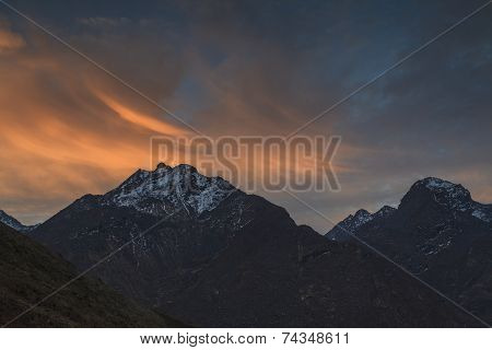 High Mountains At Sunset