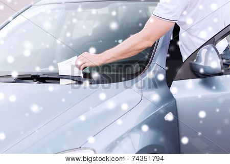 transportation and vehicle concept - close up of parking ticket on car windscreen