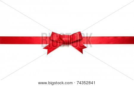 Red ribbon tie with very long ribbon extending on both sides. Isolated on white.