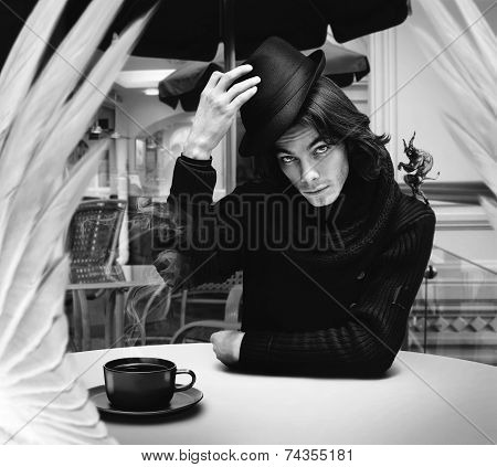 Devil Drinking Coffee With Angel