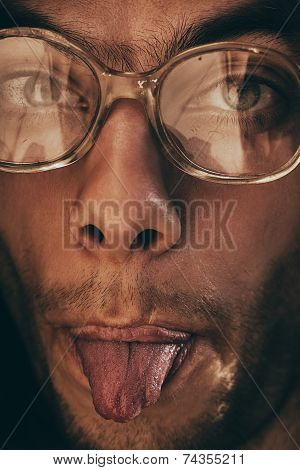 Funny Man In Glasses Showing Tongue