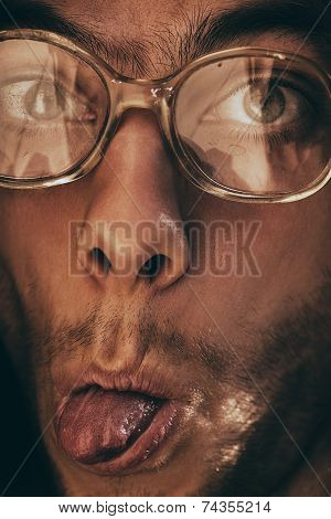 Funny Man In Glasses Shows Tongue