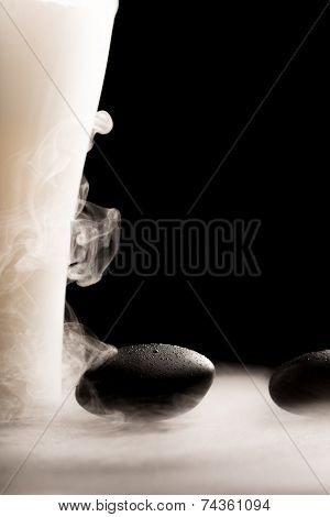 Spa Massage Stone With Wafting Tendrils Of Smoke